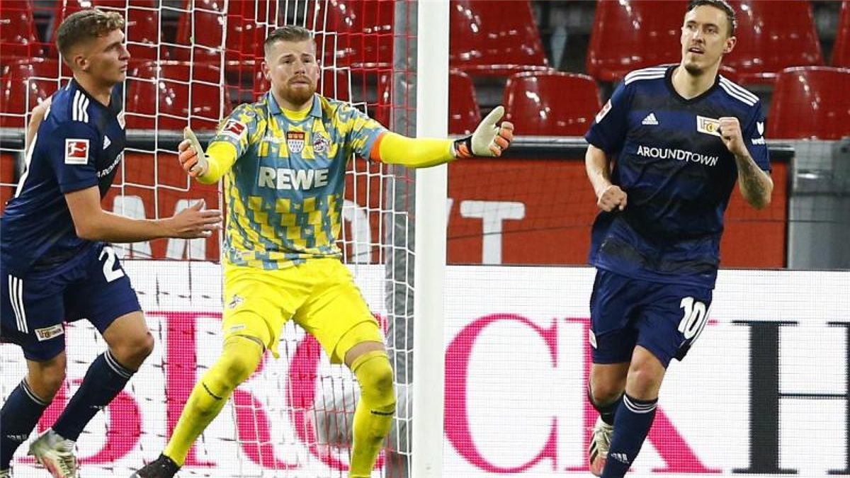 Max Kruse (r) machte den Union-Sieg in Köln perfekt. Foto: Thilo Schmuelgen/Reuters Images Europe/Pool/dpa